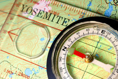 Navigational Compass on Topographical Map Royalty Free Stock Image