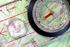Navigational Compass on Topographical Map Stock Image