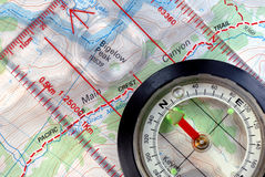 Navigational Compass on Topographical Map Royalty Free Stock Photo