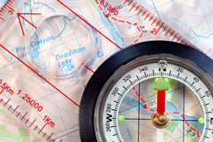 Navigational Compass on Topographical Map Stock Photography