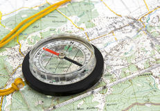 Navigational Compass on Topographical Map royalty free stock photos