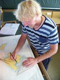 Navigational duty officer insert the position into the sea chart Royalty Free Stock Image