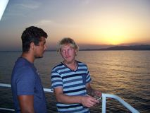 Navigational officer is explaining how to appoint the absolute humidity of the air. Officer is explaining the trainee how to appoint the absolute humidity of the Royalty Free Stock Image