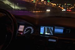 Navigator panel of the car at night. The city lights royalty free stock photos