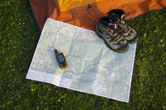 Navigator on paper map. Navigator and boots on map Stock Photos