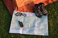 Navigator on paper map. Navigator and boots on map Stock Images