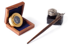 Navigator's Set. Compas, wooden box, antique glass inkwell and wooden pen isolated over white background Royalty Free Stock Photography