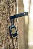 Navigator stuck into a tree with a knife stock photo