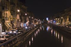 Navigli by night in Milan. Scenic night shot of a canal in Milan with reflections on the water Royalty Free Stock Photography