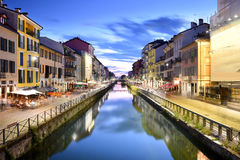 Naviglio Grande Canal at the Blue Hour, Milan, Italy. Cityscape in Milan at the Naviglio Grande Canal with historical buildings reflected in the water. The blue Royalty Free Stock Photography