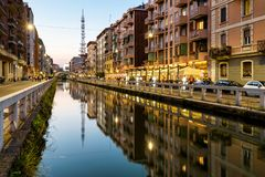 Naviglio Grande canal in the evening, Milan, Italy. Naviglio Grande is one of the main tourist attractions of Milan. Panoramic night view of Milan Royalty Free Stock Images