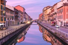Naviglio Grande canal in Milan, Lombardia, Italy. Bridge across the Naviglio Grande canal at sunrise, Milan, Lombardia, Italy Royalty Free Stock Photos