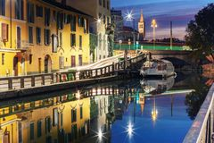 Naviglio Grande canal in Milan, Lombardia, Italy. Bridge across the Naviglio Grande canal at sunrise, Milan, Lombardia, Italy Stock Photos