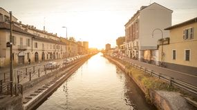 Naviglio Grande from Milan. Beautiful sunset light illuminates the whole scene of Naviglio Grande. This is a typical sunset scene you can admire in Milan,Italy stock images