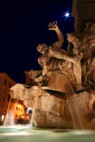 Navona night. Detail of the Fountain of the Four Rivers in Piazza Navona, Rome. Master piece of Gian Lorenzo Bernini Stock Photos