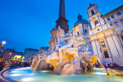 Navona square in Rome, Italy. Fountain of the four Rivers and SantAgnese in Agone on Navona square in Rome, Italy, Europe shot at dusk royalty free stock image
