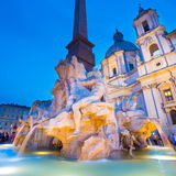 Navona square in Rome, Italy. Fountain of the four Rivers and SantAgnese in Agone on Navona square in Rome, Italy, Europe shot at dusk royalty free stock photo