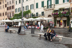 Navona Square Rome Italy. ROME, ITALY - JUNE 18, 2014: Piazza Navona under the rain with many tourists not daunted by the bad weather hitting Rome for the fourth stock photo
