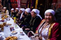 Navruz Celebrations. Fort Shevchencko, Mangystau/Kazakhstan, March 22 2015: Traditional celebration of Navruz, the spring festival. Local women eating and stock photos