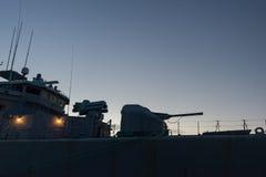 Navy Battle War Ship. Guns silhouette stock photo
