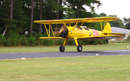 Navy Biplane. TOPPING, VA- SEPTEMBER 28: A yellow Navy Biplane durring takeoff at the 18th Annual Wings, Wheels and Keels event at Hummel Air Field Topping Stock Photos