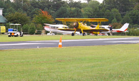 Navy Biplane. TOPPING, VA- SEPTEMBER 28: A yellow Navy Biplane at the 18th Annual Wings, Wheels and Keels event at Hummel Air Field Topping Virginia on September Stock Photos