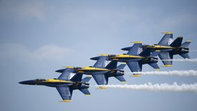 The Navy Blue Angels flying. Navy Blue Angels flying at the Joint Base Andrews airshow in Maryland royalty free stock photography