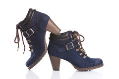 Navy blue ankle boots with chunky heels Royalty Free Stock Photos