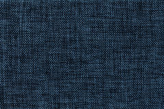 Navy blue background of dense woven bagging fabric, closeup. Structure of the textile macro. Navy blue background of dense woven bagging fabric, closeup stock images