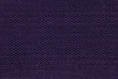 Navy blue background from a textile material with wicker pattern, closeup. Dark violet background from a textile material with wicker pattern, closeup stock images