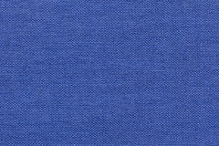 Navy blue background from a textile material with wicker pattern, closeup. Stock Photo