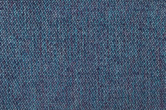 Navy blue background from woolen texture textile, closeup. Structure of the wicker fabric macro. Royalty Free Stock Photo