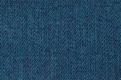 Navy blue background from woolen texture textile, closeup. Structure of the wicker fabric macro. Navy blue background from woolen texture textile, closeup stock photo