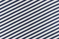 Navy blue diagonal striped textile. Closeup of navy blue diagonal striped textile Royalty Free Stock Image