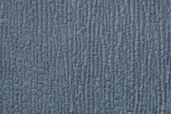 Navy blue fluffy background of soft, fleecy cloth. Texture of textile closeup Stock Image