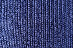 Navy blue handmade knit fabric from above. Navy blue hand made knit fabric from above Royalty Free Stock Photos