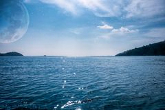 Navy blue ocean with moon and star Royalty Free Stock Photos