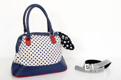 Navy blue polka dots purse and matching accessories. Royalty Free Stock Photography