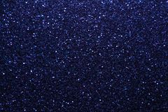 Navy blue sparkling background from small sequins, closeup. Brilliant shiny backdrop from textile. Shimmer denim paper royalty free stock image