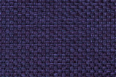 Navy blue textile background with checkered pattern, closeup. Structure of the fabric macro. Royalty Free Stock Photo