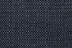 Navy blue textile background with checkered pattern, closeup. Structure of the fabric macro. Stock Images
