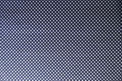 Navy blue textile with white polka dots. From above stock photography