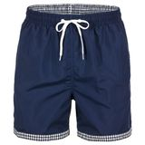 Navy blue and white with grid pattern men shorts for swimming. Isolated on white background royalty free stock photography