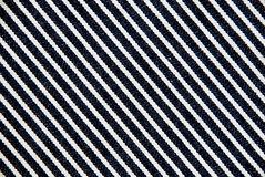 Navy blue and white striped canvas texture. Stock Images
