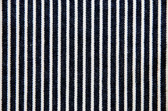 Navy blue and white striped canvas texture. Stock Photo