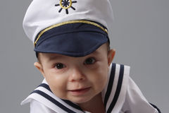 Navy Boy. One year old baby boy dressed up as a navy boy stock photo