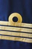 Navy captain uniform Stock Images