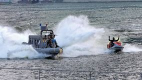 Navy chasing bandit during NDP 2009 Stock Image