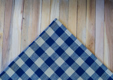 Navy Check Napkin on Wood Plank Background Royalty Free Stock Images