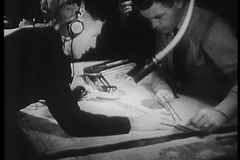 Navy crew taking measurement on map stock video footage